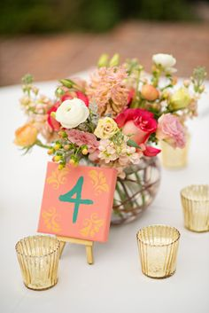 Little painted canvases with table numbers.  I have those easels available for rent.
