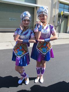 Two classical Chinese dance students from Fei Tian Academy of the Arts California in a Miao pose in their Miao costumes before the 2013 Columbus Day Parade. #community #sanfrancisco #youth #teens
