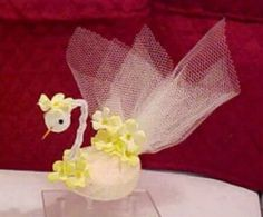 This is a vintage craft from the 60's made from nylon net and a bar of soap. The kids could help with this one. I think the shape of the Dove soap has changed so you may have to modify the pattern or the bar of soap to complete this project.
