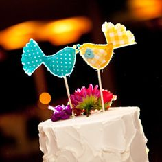 This artistic wedding had a lot of creative touches including these cake toppers & a stunning invitation suite illustrated by the groom!