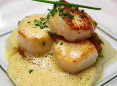Scallops are easy, delicious and elegant. These are not your typical fried or broiled. Grand Marnier is an orange liquor and when combined with cream, wine and orange juice makes for a wonderfully different experience! These have a nice fresh citrusy flav Fish Recipes, Seafood Recipes, Great Recipes, Cooking Recipes, Favorite Recipes, Whole30 Recipes, Mexican Recipes, Holiday Recipes, Seafood Scallops