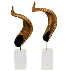 """A pair of rams horns mounted on lucite plinths. Canada. CIRCA: 1980 DIMENSIONS: 18"""" h PRICE: $450"""