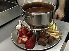 Chocolate Fondue Recipe : Food Network - FoodNetwork.com. I have all this fruit, a never been used fondue pot and a love for chocolate, why not.