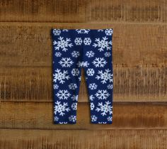 Snowflakes Christmas Kids Leggings  Artwork in baby friendly sizes on our printed leggings for your little ones. Made with our signature knit fabric, milled in Montreal. Super stretchy for easy movement. Made to last, our fabric won't lose shape and our vibrant prints never fade