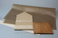 Make Dolls House Floors, Trim & Furniture from Iron On Veneer Edge Banding Trim: Iron on veneer tape with a pressing cloth, a quarter scale wall with wainscoting and moldings and a quarter or O scale wooden floor made from the tape.
