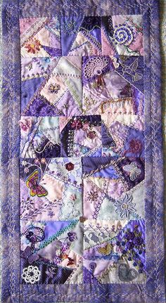 "I ❤ crazy quilting . . . Purple gives joy- My DYB RR on the Crazy Quilters around the World. A small wallhanging in one of my favourite colors. I added six 4"" blocks to get the work more 'rhythm'. by Helinacq"