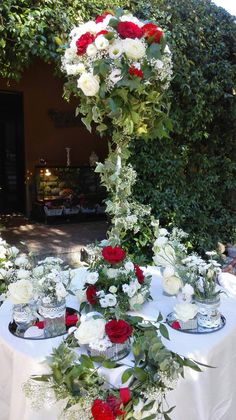 Red an d white talk center pieces...Roses Lisianthus Gypsofila....beautiful!!!!