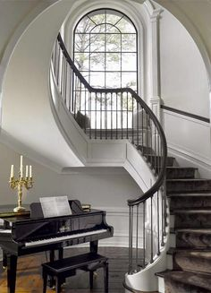 traditional large foyer with piano