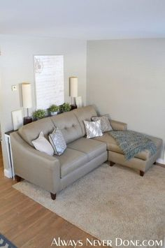 Love the skinny table behind this couch. We have the perfect spot for that if the kiddo and puppy won't knock everything down!