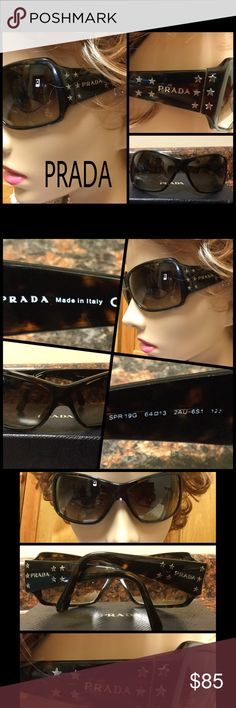 Authentic PRADA Black Silver Stars Sunglasses Authentic, PRADA made in Italy. Sunglasses with brown lenses, and tortoise shell frames accented with small silver stars surrounding the PRADA name. The serial number is SPR 19G AU-6 S1.  They come with a PRADA box. The box is in clean, good condition. The sunglasses are preowned, in very good condition. The lenses and frames do show some signs of wear consisting of micro scratches, not seen. From smoke free home with pets. No holds or trades…