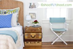 adore this space!!! Love the headboard the colors, that adorable side trunk table. Love it! Photography by the amazing brains and talent behind shootflyshoot.com
