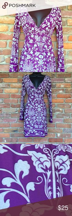 """😘Plunging Neckline Dress😘 This dress has a va-va-voom neckline! Very sexy, although you could wear a cami under it for a more demure look. polyester type material that has lots of movement. Empire waist. Purple and white with reeeeally small gold flecks. (You can kind of see them in the last picture.) Arm pit to arm pit measures approximately 16"""". Length from top of shoulder to hem is about 35.5"""". In Excellent Used Condition. Miuse Dresses Midi"""