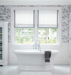 Changing your bathroom? some light colors will make your bathroom stand out, even if you have paneling, some white paint and elegant touch of wallpaper will change the look of your bath just like this one.  La Dolce Vita: Dream Home: Caitlin Wilson Design