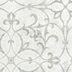 Marabel, a hand cut mosaic, is shown in honed Thassos and polished Calacatta Tia marble.