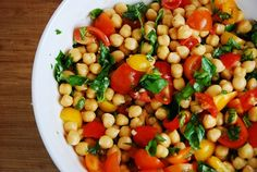 CHICKPEA & TOMATO SALAD: 1 15oz can garbanzo beans, rinsed and drained  1 pint of cherry or sugar plum tomatoes, halved  1 cup basil leaves, chopped  4 cloves garlic, minced  2 tbsp fresh lemon juice  1 tbsp honey  1 tbsp olive oil  Salt and pepper to taste