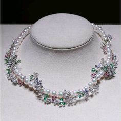 A whimsical design of Emeralds, Rubies, Garnets, Tanzanite and Diamonds weaves around this Akoya strand. Chanel Jewelry, Pearl Jewelry, Jewelry Art, Jewelry Design, Jewellery, J Necklace, Emerald Necklace, Mikimoto Pearls, Pearl Color