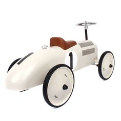 Vilac metal cream ride on classic car features a large number '1' printed on both sides, a brown plastic seat, a silver metal steering wheel, with two