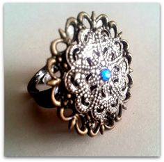 New item! Silver and bronze setting. Blue rhinestone. Adjustable. 25$