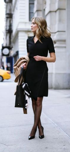 camel tie waist classic wool coat black faux wrap front v-neck short sleeve sheath dress sheer black tights timeless black pointed toe pumps gold choker necklace work tote bag Trendy Dresses, Nice Dresses, Casual Dresses, Dresses For Work, Dress Work, Workwear Dresses, Casual Outfits, Classic Dresses, Awesome Dresses