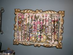 Beaded bracelet display from an old frame