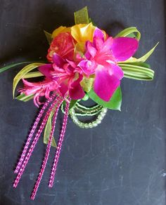 Wrist corsage in hot pink, lime and yellow, with bling trim.  Worcester florists - Sprout: Prom Flowers 2013