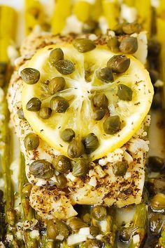 Pacific Cod and Asparagus with Garlic Lemon Caper Sauce baked in foil! A delicious and easy recipe to cook any white fish
