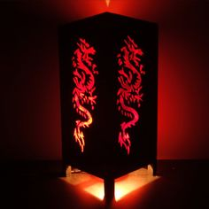 Asian Oriental Red Japanese Dragon Bedside Floor or Table Lamp or Bedside Wood Paper Light Shades Furniture Home Decor. $15.97, via Etsy.