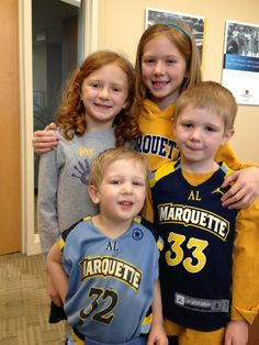 The next generation of Marquette fans. Littlest to biggest – Benjamin (3), George (5), Ella (6) and Meg Dorrington (8)