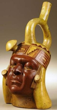 Stirrup-spout Portrait Vessel Moche A. 300 - 600 Polychrome ceramic Height 11 in. Width 6 in. This - Available at 2006 September Pre-Columbian. Ancient Peruvian, Peruvian Art, Maya Art, Colombian Art, South American Art, Mesoamerican, Indigenous Art, Ancient Artifacts, Ancient Civilizations
