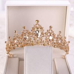 Buy Gold Crystal Quinceañera Tiara and other quinceanera products on Mi Padrino for quinceaneras, tres años, weddings, baby showers, and other events in the Hispanic community. Charro Quinceanera Dresses, Quinceanera Tiaras, Quinceanera Party, Prom Party, Prom Dresses, Gold Wedding Crowns, Baroque Wedding, Wedding Updo, Wedding Tiaras
