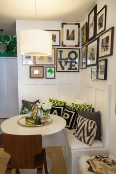 Inside a Chicago blogger's apartment...  [CLICK FOR FULL FEATURE]    wallpaper // gallery wall // grey bedroom // white paint color // kitchen renovation // white couch // banquette // breakfast nook // brass // coffee table books // west elm // cb2 // black and white // throw pillows // faux fur // foyer ideas // powder room // jonathan adler // slim aarons // ikea hack