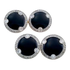 """Cartier Art Deco Cufflinks. These special circular designed double sided cufflinks with scalloped diamond borders are set with rose cut and old round cut diamonds, along with a black onyx center. Signed Cartier, Made in France, and Numbered 03172. Approximately 1/2"""" plus (13 1/2 mm) in diameter, made in platinum and 18kt gold."""