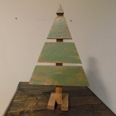 This little tree is made completely of reclaimed pallet wood. Stained a light brown and overlayed with a green to give it a rustic look. Coated with three coats of a poly acrylic finish They measure approx. 16 high and 10 wide at the widest point.