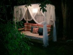 I'd love this pretty canopy outdoor bed (via ana-white)