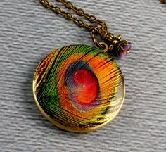 neat neat neat! peacock feather locket :) #rainbow #locket #jewelry #etsy #peacock #feather #colorful #steampunk