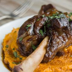 Braised Lamb Shanks & Root Vegetable Puree Recipe Main Dishes with bacon, lamb shanks, celery, carrots, onions, leeks, garlic cloves, tomato paste, dry red wine, beef stock, veal demi-glace, fresh thyme, bay leaves, ground black pepper, kosher salt, carrots, sweet potatoes, parsnips, unsalted butter, heavy cream, ground black pepper, kosher salt