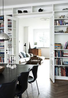 My home will not be complete without French doors and TONS of bookshelves!