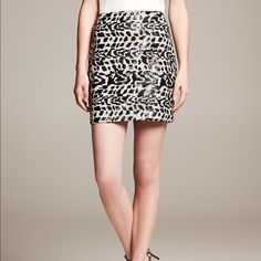 "HP🌹New BANANA REPUBLIC Heritage Sequin Zebra Mini This new black and ivory sequin zebra mini skirt from Banana Republic features a zipper closure. Sequins throughout and is fully lined.  Measures: Waist: 30"", Hips: 38"", Total length: 18"" Banana Republic Skirts Mini"