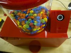 Picture of Smiley - a smile-triggered candy machine that shares!