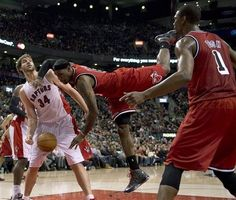 Miami Heat forward Chris Bosh (left) watches as LeBron James (centre) tumbles to the floor after trying to dunk over Toronto Raptors centre Aaron Gray (left) during first half NBA basketball action in Toronto on Sunday Feb. 3, 2013. (AP Photo/THE CANADIAN PRESS,Frank Gunn)