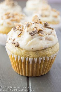 Browned butter banana cupcakes topped with vanilla buttercream frosting, speckled with chocolate toffee bits. So irresistible you can't stop at one!
