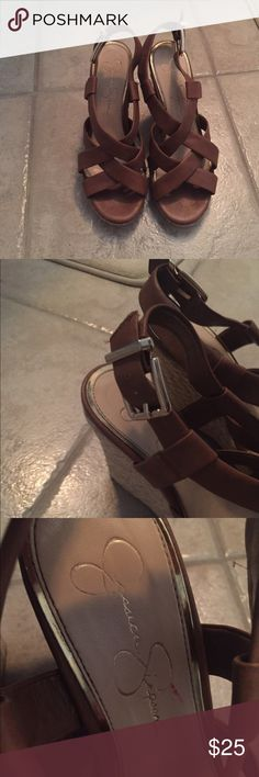 Jessica Simpson wedges Jessica Simpson brown strappy wedges size 8. Only worn twice so they are still in excellent condition. There is a small red nail polish stain on one of the footbeds (3rd picture). Jessica Simpson Shoes Wedges