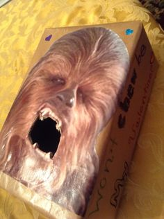 """C's Chewbacca Valentine box this year.  Easy valentines box.  Print pic of the wookie, cut hole for mouth, cover box with paper, trace mouth hole on box, cut hole in box, write  clever sayings """"won't CHEW be my Valentine?"""" Mod Podge chewy to the box."""
