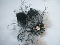 Black eackc Feather & Grey Gothic Hair Clip Order Now from Gothic Diva Designs #Gothic #Steampunk #Halloween #Wedding Fabulous Elegant Gothic, Victorian Vintage & Steampunk inspired designs,  Including mini hat fascinators, feathered hair clips, ostrich & peacock feather fans,  saucer hats, wedding bouquets, bandeau veils and wristlets. www.gothicdivadesigns.co.uk