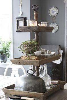 Tiered trays - love.  Use weathered frames? And candle stick? Both in basement.