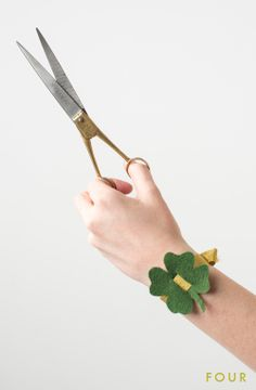 gold ribbon with green felt shamrock