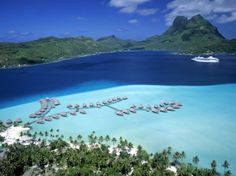 Google Image Result for http://imgc.allpostersimages.com/images/P-473-488-90/26/2662/JZGUD00Z/posters/walter-bibikow-pearl-beach-resort-bora-bora-french-polynesia.jpg