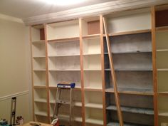 Zinnser B. Primer: Home Depot Behr Premium Plus Interior/Exterior Paint in Pure White: Home Depot. Transforming stock Ikea Billy Bookcases into a built-in bookcase wall. Custom results on a budget! Plywood Bookcase, Cheap Bookshelves, Bookcase Wall, Bookshelves Built In, Built Ins, Billy Ikea, Ikea Billy Bookcase Hack, Billy Bookcases, Ikea Shelves