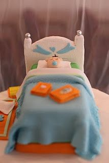 Cute cake to go with the bedtime stories baby shower theme; but I would want the lil babe in a crib not a bed lol  [Bedtime Stories Baby Shower Cake]