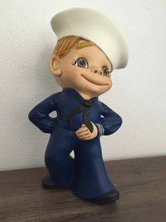 A personal favorite from my Etsy shop https://www.etsy.com/listing/463941801/hand-painted-ceramic-sailor-boy-figurine